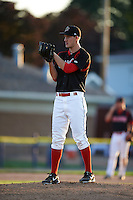 Batavia Muckdogs pitcher Justin Langley (19) gets ready to deliver a pitch during the second game of a doubleheader against the Mahoning Valley Scrappers on July 2, 2015 at Dwyer Stadium in Batavia, New York.  Mahoning Valley defeated Batavia 3-0.  (Mike Janes/Four Seam Images)