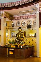 Buddha Demonstrating the Earth Witness (Bhumisparsha) Mudra inside the  International Buddhist Pagoda, Maha Vihara Buddhist Temple, Kuala Lumpur, Malaysia.