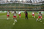 Scotland 3  Wales 1, 25/05/2011. Aviva Stadium, Carling Nations Cup. Wales players going through their pre-match warm-up routine at Aviva Stadium before the Carling Nations Cup match between Scotland and Wales. Scotland won the match by 3 goals to 1.The multi-sports venue was originally known as Lansdowne Road and was reopened in 2010 after it was completely redeveloped. Photo by Colin McPherson.