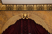 Detail of the carved and gilded curtain pelmet and frieze in the Egyptian dining room