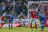 Ash Huner of Fleetwood Town (centre) celebrates after he scores his team's first goal during the Sky Bet League 1 match between Fleetwood Town and Peterborough at Highbury Stadium, Fleetwood, England on 19 April 2019. Photo by Stefan Willoughby.