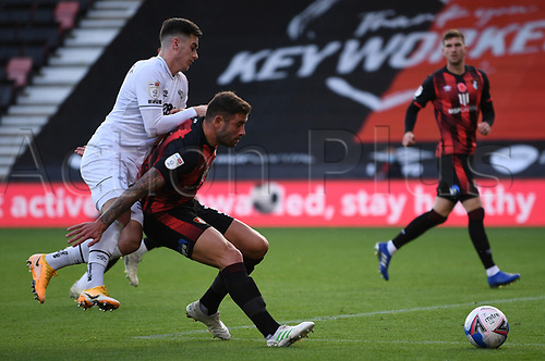 31st October 2020; Vitality Stadium, Bournemouth, Dorset, England; English Football League Championship Football, Bournemouth Athletic versus Derby County; Tom Lawrence of Derby County competes for the ball with Steve Cook of Bournemouth