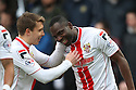 Francis Zoko of Stevenage (r) scores the opening goal and celebrates with Luke Freeman<br />  - Stevenage v Portsmouth - FA Cup 1st Round  - Lamex Stadium, Stevenage - 9th November, 2013<br />  © Kevin Coleman 2013