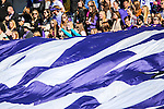 TCU students scroll out a large flag during the game between the Oklahoma State Cowboys and the TCU Horned Frogs at the Amon G. Carter Stadium in Fort Worth, Texas.