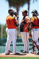 GCL Orioles pitching coach Wilson Alvarez (47) talks with starting pitcher Yelin Rodriguez (37) as shortstop Irving Ortega (1) and catcher Jean Carrillo (36) listen in during a game against the GCL Twins on August 11, 2016 at the Ed Smith Stadium in Sarasota, Florida.  GCL Twins defeated GCL Orioles 4-3.  (Mike Janes/Four Seam Images)