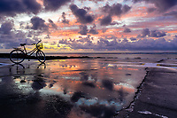 Helicopter airstrip sky and tourist bike reflection at sunrise on Bora Bora island, a honeymoon destination, near Tahiti, Polynesia, Pacific Ocean