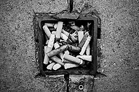 Switzerland. Canton Ticino. Lugano. Cigarette butts in metal open-air ashtray. Illegal waste dumping and littering on the street. 2.07.2020 © 2020 Didier Ruef