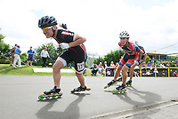 11 AUG 2013 - BIRMINGHAM, GBR - George Kirkman (left) of East Midlands Racing leads James Ashby of Wisbech Inline Speed Skating Club onto a new lap during the Senior Men's 10,000m Points Final at the Federation of Inline Speed Skating 2013 British Outdoor Championships ay Birmingham Wheels Park in Birmingham, West Midlands, Great Britain (PHOTO COPYRIGHT © 2013 NIGEL FARROW, ALL RIGHTS RESERVED)