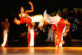 Natal, Brazil. Folk dance show; male dancers in red and white costumes.