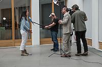 """Vorstellung des Report """"Leben in Unsicherheit"""" von Amnesty International-Deutschland am Donnerstag den 9. Juni 2016 in der Bundespressekonferenz.<br /> Im Bild: Selmin Caliskan, Generalsekretaerin der deutschen Sektion von Amnesty International bei einem Interview.<br /> 9.6.2016, Berlin<br /> Copyright: Christian-Ditsch.de<br /> [Inhaltsveraendernde Manipulation des Fotos nur nach ausdruecklicher Genehmigung des Fotografen. Vereinbarungen ueber Abtretung von Persoenlichkeitsrechten/Model Release der abgebildeten Person/Personen liegen nicht vor. NO MODEL RELEASE! Nur fuer Redaktionelle Zwecke. Don't publish without copyright Christian-Ditsch.de, Veroeffentlichung nur mit Fotografennennung, sowie gegen Honorar, MwSt. und Beleg. Konto: I N G - D i B a, IBAN DE58500105175400192269, BIC INGDDEFFXXX, Kontakt: post@christian-ditsch.de<br /> Bei der Bearbeitung der Dateiinformationen darf die Urheberkennzeichnung in den EXIF- und  IPTC-Daten nicht entfernt werden, diese sind in digitalen Medien nach §95c UrhG rechtlich geschuetzt. Der Urhebervermerk wird gemaess §13 UrhG verlangt.]"""