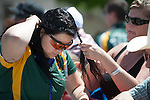 Aubrey Modrell, 17,  a member of Sonora High Trap Club gets her hair braided by Rita Cosseboon, a team mom, during the California Youth Shotgun Shooting Association's championship shootout at the Capitol City Gun Club in Carson City, Nev. on Saturday, May 2, 2015.<br /> Photo by Kevin Clifford/Nevada Photo Source