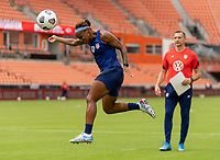 HOUSTON, TX - JUNE 9: Crystal Dunn #19 of the USWNT heads the ball during a training session at BBVA Stadium on June 9, 2021 in Houston, Texas.