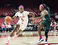 COLLEGE PARK, MD - FEBRUARY 03: Kaila Charles #5 of Maryland moves past Nia Clouden #24 of Michigan State during a game between Michigan State and Maryland at Xfinity Center on February 03, 2020 in College Park, Maryland.