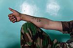 19/07/14  Iraq -- Daquq, Iraq -- Tattoos on the arm of a Peshmerga.