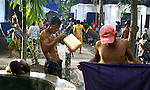 Cyclone Nargis survivors wash at a temple turned into a makeshift refugee center in the town of Labutta, in Irrawaddy Division, May 10, 2008. Despairing survivors in Myanmar awaited emergency relief on Friday, a week after 100,000 people were feared killed as the cyclone roared across the farms and villages of the low-lying Irrawaddy delta region. The storm is the most devastating one to hit Asia since 1991, when 143,000 people were killed in neighboring Bangladesh. Photo by Eyal Warshavsky  *** Local Caption *** ëì äæëåéåú ùîåøåú ìàéì åøùáñ÷é àéï ìòùåú áúîåðåú ùéîåù ììà àéùåø