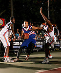 Jerryd Bayless (5) drives to the basket between Rick Jackson (40) and Corey Stokes (23) during the Elite 24 Hoops Classic game on September 1, 2006 held at Rucker Park in New York, New York.  The game brought together the top 24 high school basketball players in the country regardless of class or sneaker affiliation.