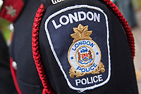 London Police badge is seen during a police memorial parade in Ottawa Sunday September 26, 2010.