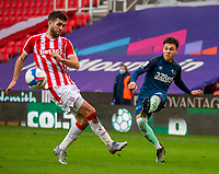 20th March 2021; Bet365 Stadium, Stoke, Staffordshire, England; English Football League Championship Football, Stoke City versus Derby County; Lee Buchanan of Derby County crosses the ball