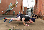 December 22, 2014. Lexington, North Carolina.<br />  Mayor Newell Clark performs a variation of a pushup with his exercise group on the site of the abandoned Lexington Furniture factory.<br />   Newell Clark, the 43 year old mayor of Lexington, NC, leads a group of friends and colleagues on a 4 times a week exercise routine around downtown. The group uses existing infrastructure, such as an abandoned furniture factory, loading docks, stairs, and handrails to get fit and increase awareness of healthy lifestyles in a town more known for BBQ.<br /> Jeremy M. Lange for the Wall Street Journal<br /> Workout_Clark