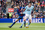 Sergio Busquets of FC Barcelona (L) competes for the ball with Maxi Gomez of RC Celta de Vigo (R) during the La Liga 2017-18 match between FC Barcelona and RC Celta de Vigo at Camp Nou Stadium on 02 December 2017 in Barcelona, Spain. Photo by Vicens Gimenez / Power Sport Images