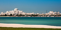 White sand beach with the turquoise Persian Gulf Sea, the Emirates Palace, and luxury boats in the background, in Abu Dhabi UAE, Asia