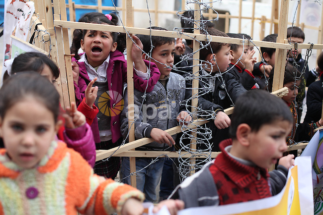 Palestinian children protest outside of United Nations Development Programme office (UNDP) in solidarity with hunger-striking Palestinian prisoners held by Israel, demanding their release, in Gaza city on Feb. 05, 2013.. Photo by Majdi Fathi