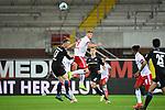28.09.2020, Benteler-Arena, Paderborn, GER, 2. FBL SC Paderborn 07 vs. Hamburger SV<br />  <br />im Bild<br />Sebastian Schonlau (SC Paderborn 07, 13) im Kopfballduell gegen Simon Terodde (Hamburger SV, 9)<br /><br />DFL regulations prohibit any use of photographs as image sequences and/or quasi-video. <br /><br />Foto © nordphoto / Paetzel