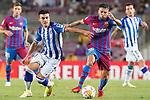 FC Barcelona's Jordi Alba (r) and Real Sociedad's Ander Barrenetxea during La Liga match. August 15, 2021. (ALTERPHOTOS/Acero)