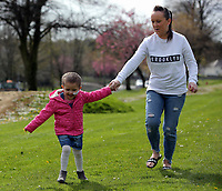 "COPY BY TOM BEDFORD<br /> Pictured L-R: Mia Chambers running with her mum Kirsty<br /> Re: One of Britain's poorest towns is raising £100,000 to send a little girl to America because the lifesaving drugs she needs are not available on the NHS.<br /> Brave Mia Chambers, five, is in remission after having an ovary and kidney removed due to neuroblastoma, a rare and aggressive type of cancer.<br /> Doctors have told her parents Josh and Kirsty there is a 50 per cent chance of the cancer returning without the specialist drugs.<br /> Josh, 28, said: ""That's not a chance we are prepared to take - the odds are too high.<br /> ""We researched it on the internet and found children in the US are beating this terrible illness.<br /> ""Doctors there are willing to treat her but it will cost more money than we have.""<br /> The couple's plight has touched the hearts of people in their home town of Merthyr Tydfil, South Wales, and money has begun pouring in.         <br /> Mia had chemotherapy on the Rainbow ward at the Noah's Ark Children's Hospital for Wales where nurses nicknamed her the Rainbow Warrior because of her fighting spirit."