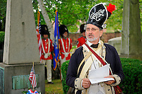 Captain Richard Swartwout of the 6th Connecticut Regiment, Company of Light Infantry, and member of the General David Humphreys' Branch of the Sons of the American Revolution, reads the Declaration of Independence at the General's grave during a July Fourth ceremony to recognize fallen patriots of the Revolutionary War, Grove Street Cemetery, New Haven, Connecticut, USA.