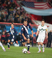 The USA's Landon Donovan dribbles the ball as Slovenia's Robert Koren looks on in the second half of the 2010 World Cup match between USA and Slovenia at Ellis Park Stadium in Johannesburg, South Africa on Friday, June 18, 2010.  The USA tied Slovenia 2-2.