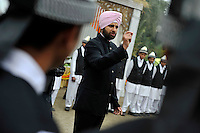 At the reception after a wedding ceremony of British/Punjabi couple Lindsay and Navneet Singh at Grewal Farms in Amritsar, the groom gives instructions to waiting staff.
