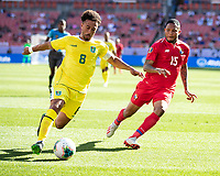 CLEVELAND, OH - JUNE 22: Samuel Cox #8 controls the ball in front of Eric Davis #15 during a game between Panama and Guyana at FirstEnergy Stadium on June 22, 2019 in Cleveland, Ohio.