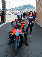 Jul 21, 2019; Morrison, CO, USA; NHRA pro stock motorcycle rider Andrew Hines and teammate Angelle Sampey during the Mile High Nationals at Bandimere Speedway. Mandatory Credit: Mark J. Rebilas-USA TODAY Sports
