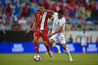 Orlando, FL - Monday June 06, 2016: Panama forward Blas Pérez (7) and Bolivia defender Ronald Eguino (21) during a Copa America Centenario Group D match between Panama (PAN) and Bolivia (BOL) at Camping World Stadium.