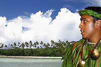 Cook Island dancer (MR) , South Pacific island scene with palm trees and beach. Rarotonga, The Cook Islands.