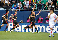 Mexico's Andres Guardado gets a hug from teammate Israel Castro after scoring one of his two goals.  Mexico defeated Costa Rica 4-1 at the 2011 CONCACAF Gold Cup at Soldier Field in Chicago, IL on June 12, 2011.