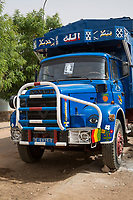 """Senegal, Touba.  Truck.  The photo on the windshield is of Cheikh Ahmadu Bamba, founder of the Mouride Islamic brotherhood.  This indicates that either the owner of the truck, or the driver, is a member of the brotherhood.  Painted in white above the windshield is """"Allah."""""""
