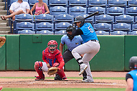 Tampa Tarpons Carlos Narvaez (5) bats in front of catcher Juan Aparicio (44) and umpire Rainiero Valero during a game against the Clearwater Threshers on June 13, 2021 at BayCare Ballpark in Clearwater, Florida.  (Mike Janes/Four Seam Images)