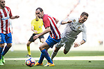 Cristiano Ronaldo (r) of Real Madrid fights for the ball with Diego Roberto Godin Leal of Atletico de Madrid during their La Liga match between Real Madrid and Atletico de Madrid at the Santiago Bernabeu Stadium on 08 April 2017 in Madrid, Spain. Photo by Diego Gonzalez Souto / Power Sport Images