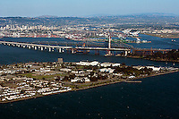 aerial photograph Treasure Island San Francisco toward Bay Bridge Construction Port of Oakland and downtown Oakland