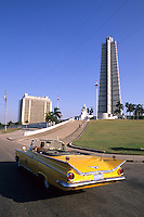 Colorful 1950's Buick convertible drives past revolution Square, Jose Marti Memorial, Havana, Cuba
