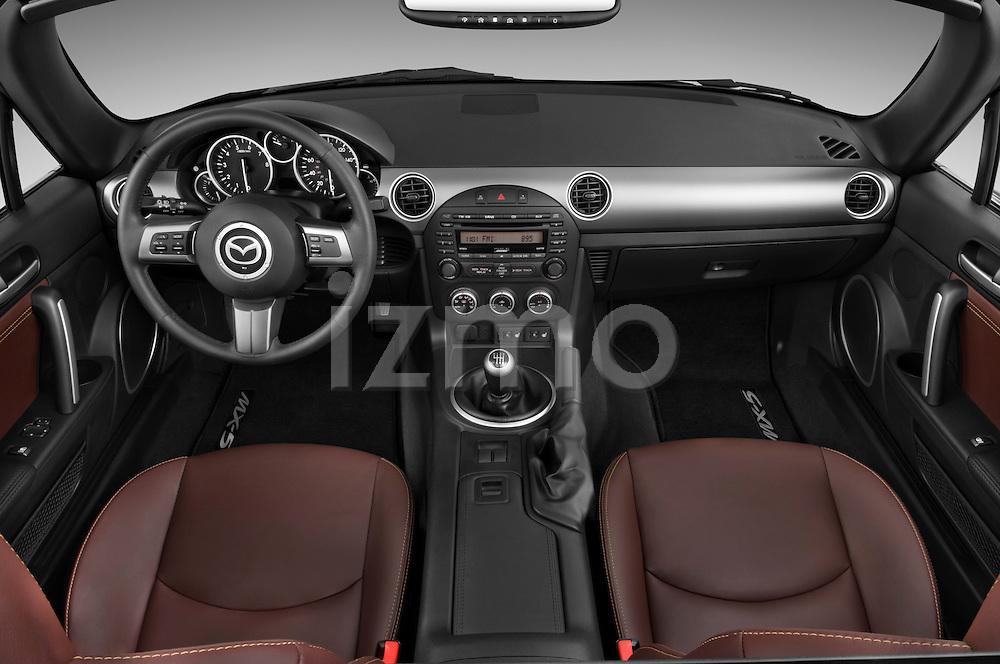 Straight dashboard view of a 2010 Mazda Miata MX5.