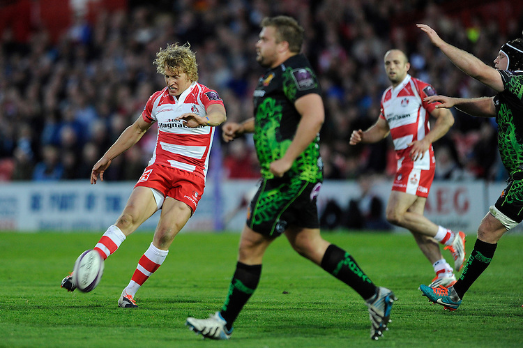 Billy Twelvetrees of Gloucester Rugby looks to drop a goal during the European Rugby Challenge Cup semi final match between Gloucester Rugby and Exeter Chiefs at Kingsholm Stadium on Saturday 18th April 2015 (Photo by Rob Munro)