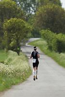 26 MAY 2013 - BRIGG, GBR - Stefan Teichert (Elite 23-39) of SG Poseiden Eppelheim / WSC Heidelberg leads the run during the 2013 Brigg Bomber Quadrathlon, a World Quadrathlon Federation World Cup round and the British Championships, held in Brigg, Lincolnshire, Great Britain (PHOTO (C) 2013 NIGEL FARROW)