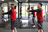 (L-R) Sam Clucas and Federico Fernandez exercise in the gym during the Swansea City Training at The Fairwood Training Ground, Swansea, Wales, UK. Wednesday 27 September 2017