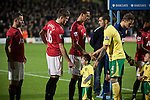 Norwich City 1 Manchester United 0, 17/11/2012. Carrow Road, Premier League. Manchester United midfielder Michael Carrick (centre) shaking a home team mascot's hand at Carrow Road stadium, home of Norwich City before the teams' Barclays Premier League fixture. The home team won the match by one goal to nil watched by a crowd of 26,840. It was Norwich City's first victory against Manchester United since 2005. Photo by Colin McPherson.