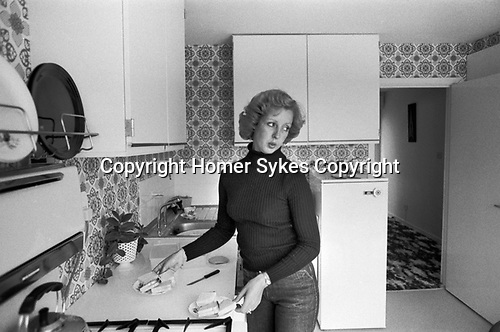 1970s England, a middle income professional mother at home in the kitchen making afternoon tea, sandwiches for the two boys, 1977 New town modern housing development  Milton Keynes Buckinghamshire.UK