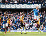 James Tavernier heads in to score for Rangers on the stroke of half-time and celebrates