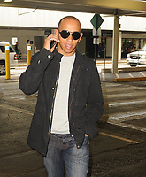 MIAMI, FL - AUGUST 02:  (EXCLUSIVE COVERAGE)  Formula One Grand Prix driver Lewis Hamilton (AKA Lewis Carl Hamilton - Born: 7-Jan-1985)  of Great Britain arrives at Miami International Airport from London to meet girlfriend Nicole Scherzinger of the Pussycat Dolls ( not pictured) . The couple was rumored to be engaged but when asked Hamilton  said no they were not engaged. August  02, 2010 in Miami, Florida<br /> <br /> <br /> People:  Lewis Hamilton